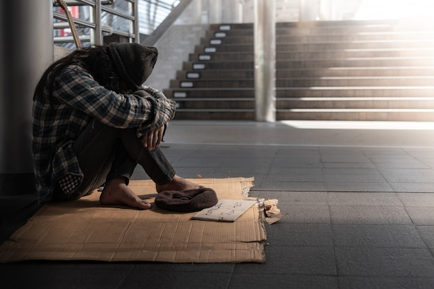 Beggars, homeless people sitting on the floor get close to ban, ask for a fraction of money Premium Photo