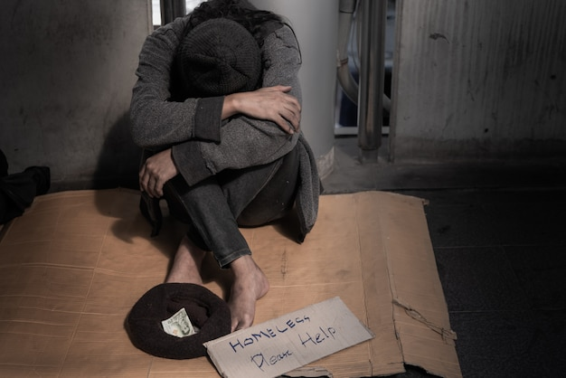 Beggars, homeless sitting on the floor, ask for a fraction of money from people. Premium Photo