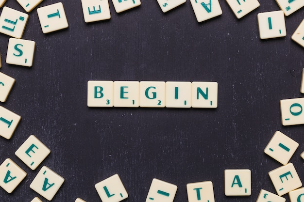 Begin word arranged with scrabble letters Free Photo
