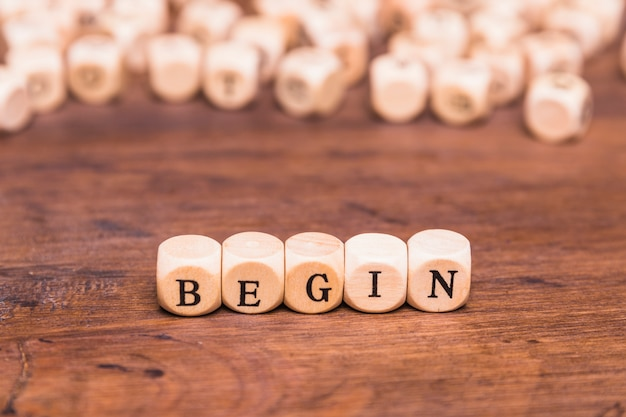 Begin word on wooden cubes Free Photo