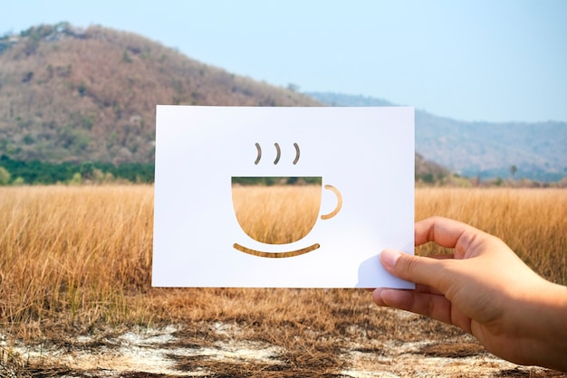Beginning new day with cup of coffee perforated paper Free Photo