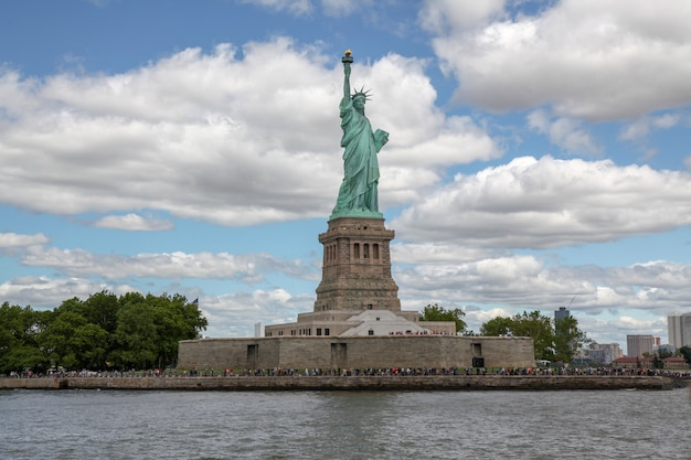 Behide the statue of liberty is american symbol have famous in new york, usa Premium Photo