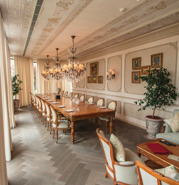 A beige colored interior dining room. Free Photo
