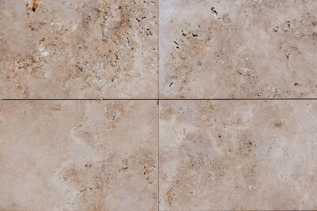 Beige concrete wall. sandstone texture tile