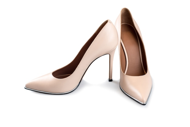 Beige high heel shoes isolated on white Premium Photo