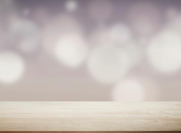 ボケ味のライトが付いているベージュの木の板 無料写真