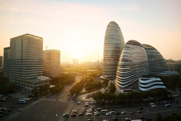Beijing cityscape and famous landmark building in wangjing soho area during sunset in beij Premium Photo