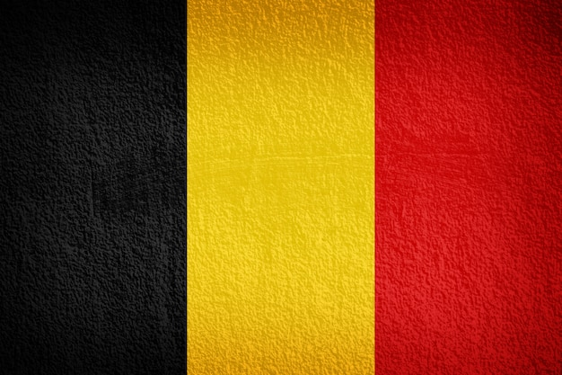 Belgian flag painted on grunge wall Premium Photo