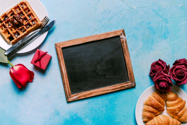 Belgian waffle with croissants and chalkboard Free Photo
