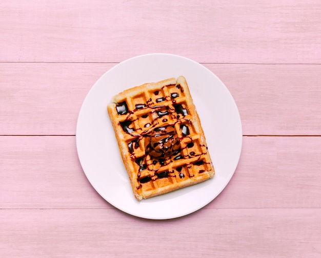 Belgian waffle with topping on plate Free Photo