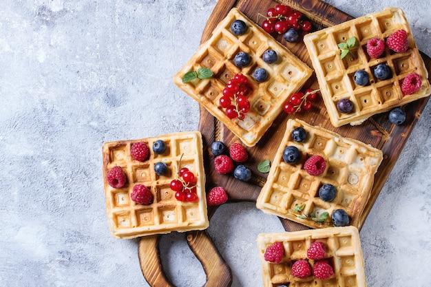 Belgian waffles with berries Premium Photo