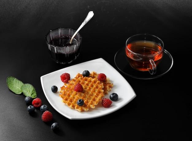 Belgian waffles with fresh berries and honey Premium Photo