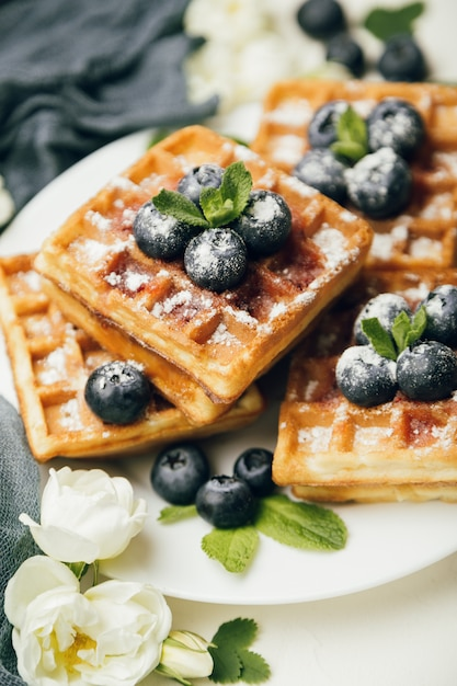 Belgian waffles with fresh berries and mint Premium Photo