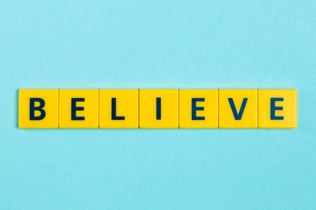 Believe word on scrabble tiles Premium Photo