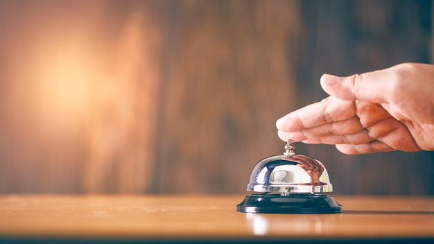 Bell call vintage service with hand Premium Photo