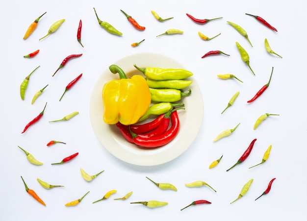 Bell pepper and chili peppers isolated on white Premium Photo