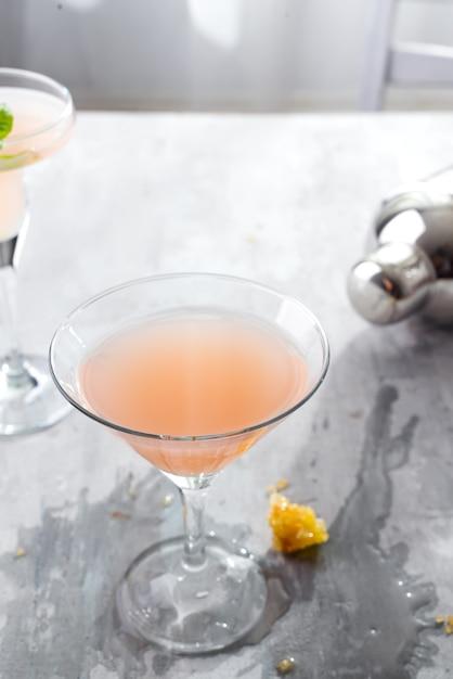 Bellini cocktail with peach and honey Premium Photo