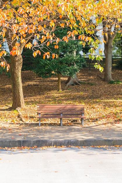 Bench in autumn park Free Photo