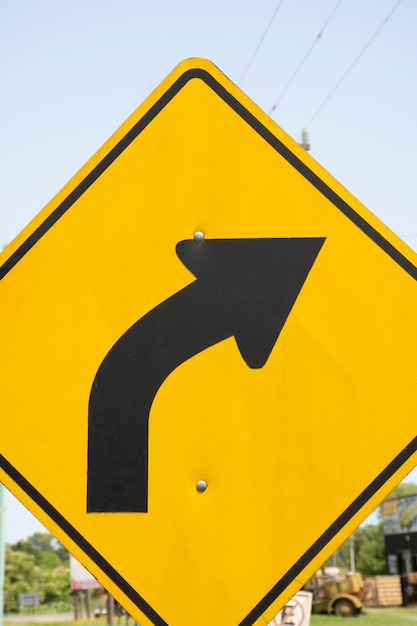 Bend to right arrow line traffic sign Free Photo