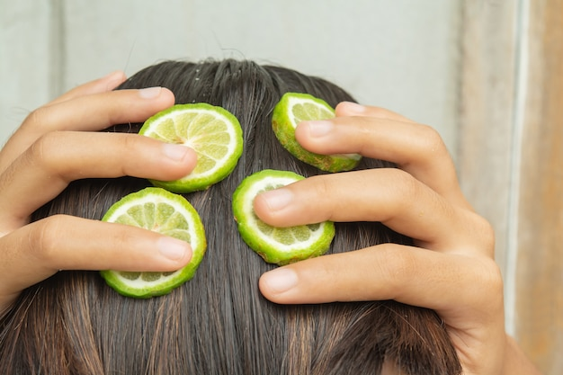 Bergamot and treatment of hair and scalp that is itching and falling Premium Photo