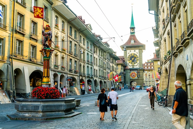 Bern, switzerland - 23 aug 2018: people on the shopping alley with the zytglogge astronomical clock tower of bern in switzerland Premium Photo