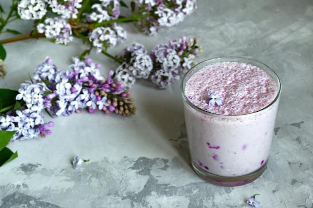 Berry milkshake in a glass on gray Premium Photo