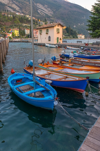 Berth with boats in the town riva del garda. italy. pier in riva del garda. Premium Photo