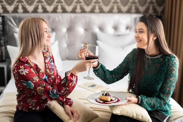Best friends enjoying their day with food and wine Free Photo
