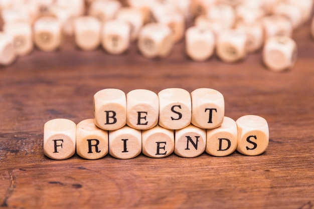 Best friends word with wooden dices over desk Free Photo