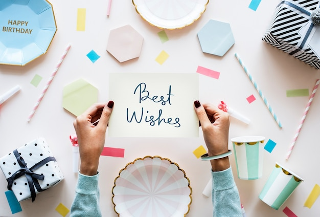 Best wishes card in a party themed background Premium Photo