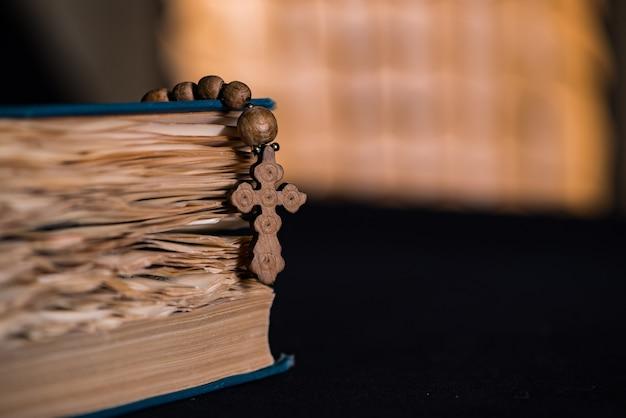 Bible and cross in religious concept Premium Photo