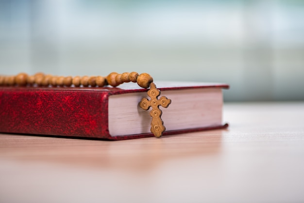 Bible and cross in religious concept Premium Photo