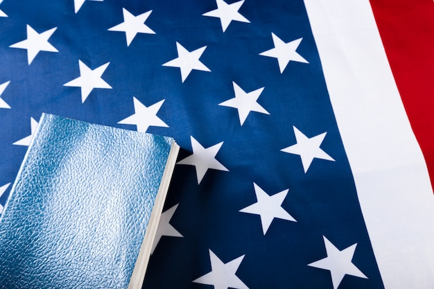 Bible laying on top of an american flag Premium Photo