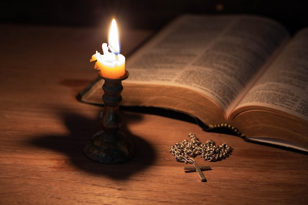 Bible, wood cross and candles Free Photo