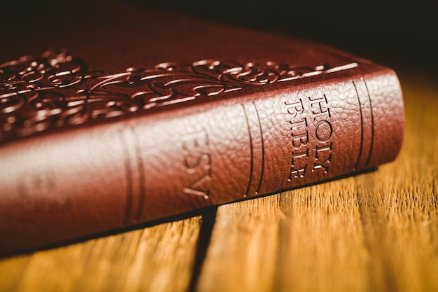 Bible on wooden table Premium Photo