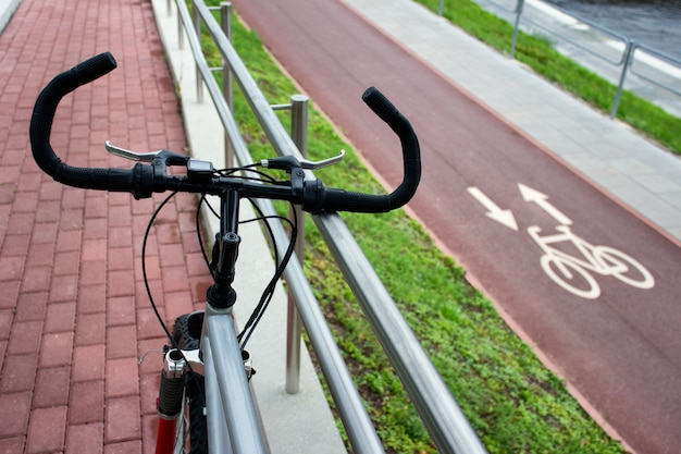 Bicycle on the background of city bike pathway with sign. Premium Photo