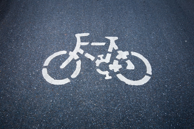 Bicycle road sign on the  road. Premium Photo