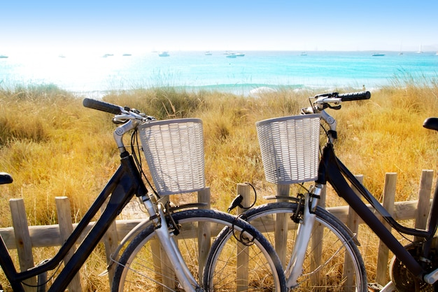 Bicycles couple parked in formentera beach Premium Photo