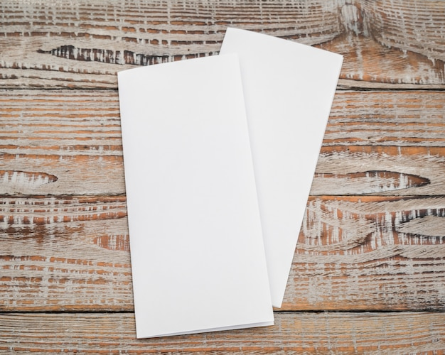 Bifold white template paper on wood texture . Free Photo
