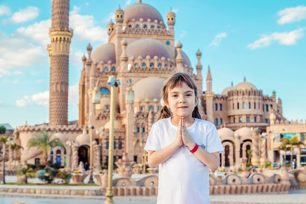 Big beautiful mosque sharm el-sheikh. the child is praying. selective focus Premium Photo
