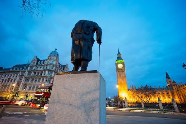 Big ben and statue of sir winston churchill, london, england Premium Photo