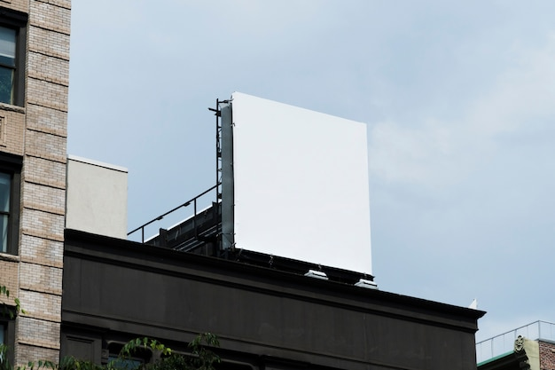 Big billboard template on building in city Free Photo
