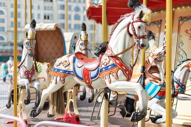 Big carousel with horses at a fair Premium Photo