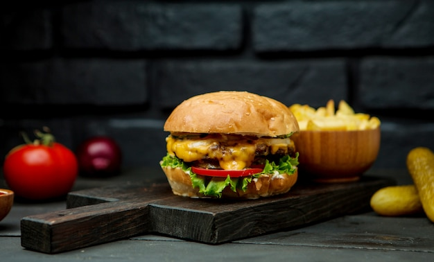 Big cheeseburger and french fries Free Photo