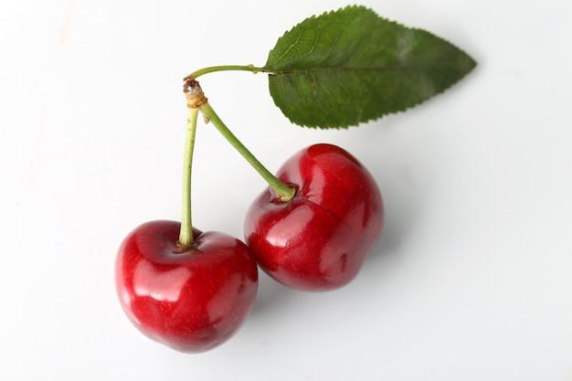 Big cherry on white background Free Photo