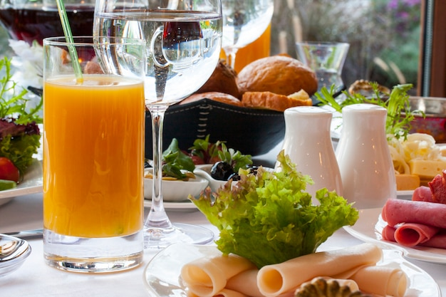 Big cold breakfast with orange juice Free Photo