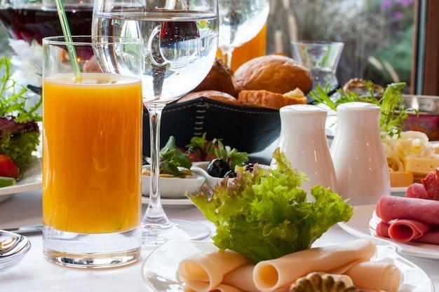 Big cold breakfast with orange juice Free Photo