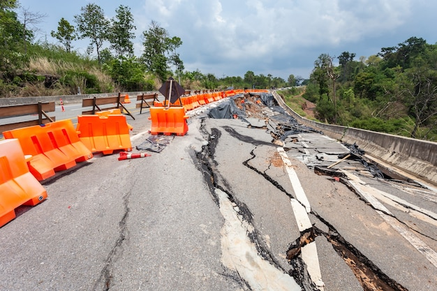Big damage of asphalt road on the hillside cause of heavy rain and sliding earth Premium Photo