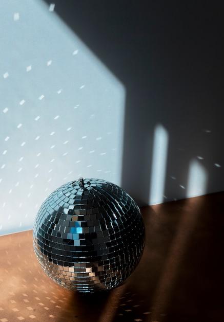 Big disco ball on brown floor Free Photo