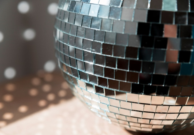 Big disco ball on floor with party lights Free Photo